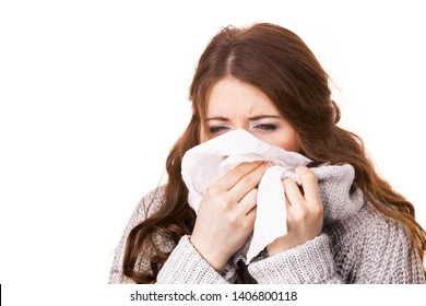 Sick freezing woman sneezing in tissue. Girl wearing warm sweater being cold and trembling. Flu or other virus. Health care.