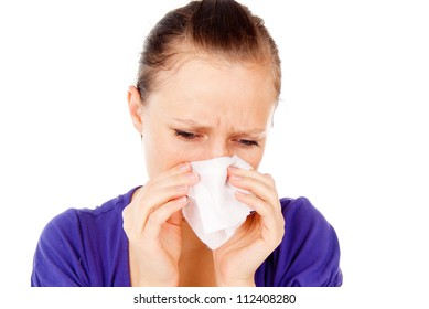 the sick girl sneezes isolated on white background