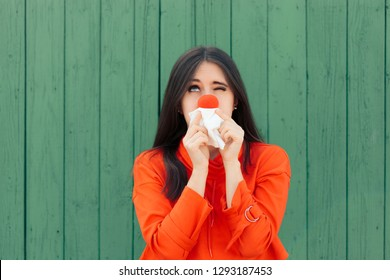 Sick Girl Suffering with Red Running Nose. Funny woman blowing her nose in allergy season