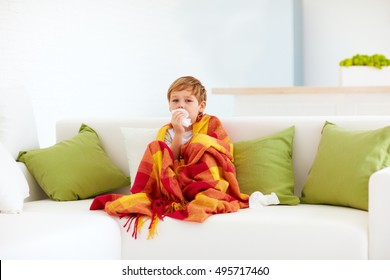 sick kid with runny nose and fever heat at home