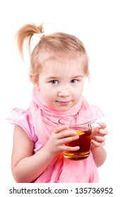 Sick little girl with chickenpox drinking tea with lemon isolated on white