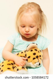 Sick little girl holds her cheetah suffie