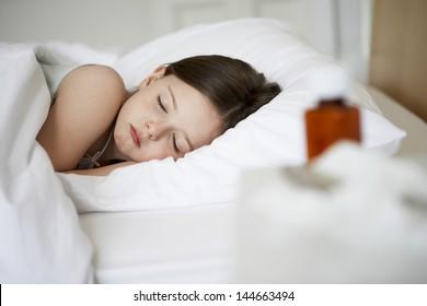 Sick little girl sleeping in bed