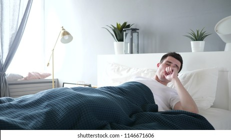 Sick Man Coughing while Sleeping in Bed