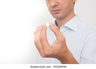Sick man eating aspirin pill medication