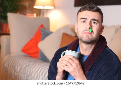Sick man with green mucus running down his nose