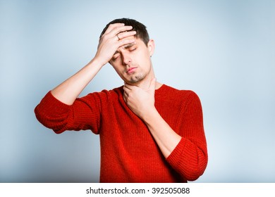 sick man has a sore throat isolated on a gray background