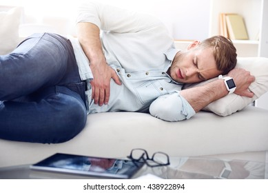 Sick man lying on the couch