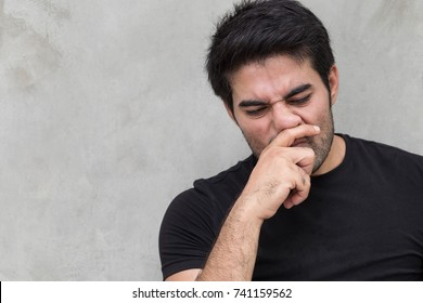 sick man with runny nose