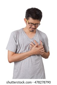 The sick man standing on white background and put his hands on his heart with painful is showing of his face.