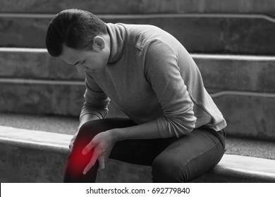 sick man suffers from knee joint pain, osteoarthritis