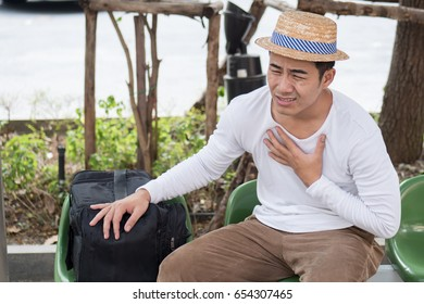 sick man traveler suffering from heart attack