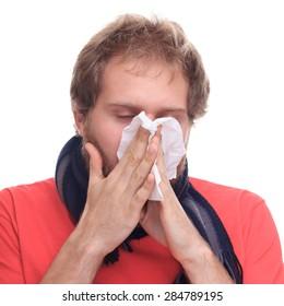 Sick man uses handkerchief