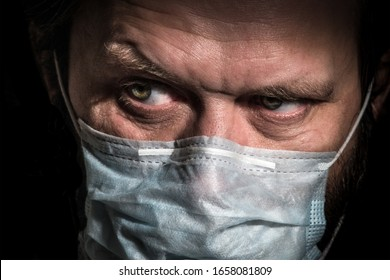 Sick old man with medical face mask portrait close up illustrates pandemic coronavirus disease on dark background. Covid-19 outbreak contamination concept.