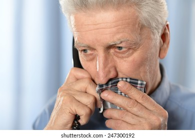 Sick old man with tooth pain call a doctor