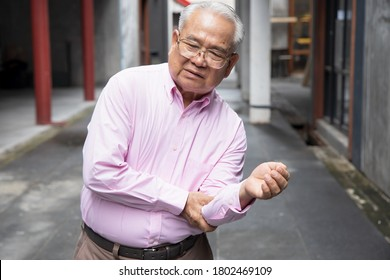 sick old senior man suffering from elbow joint pain; concept of tennis elbow or golfer's elbow syndrome, gouty pain, rheumatoid, arthritis, osteoporosis