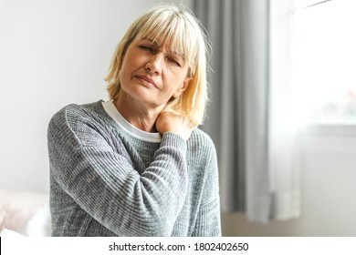 Sick senior adult elderly women touching the neck have shoulder and neck pain.Healthcare and medicine concept