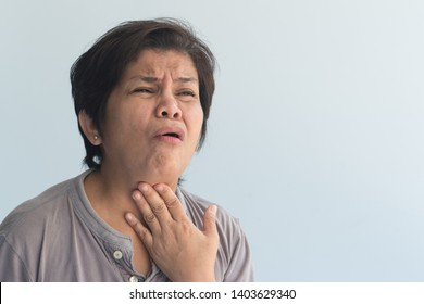 sick senior woman getting a cold or flu with sore throat, congested phlegm