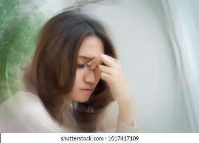 sick stressed dizzy woman suffering from vertigo, dizziness, headache portrait. asian girl woman with headache pain, overworked concept, portrait of ill woman, woman with mental sickness problem