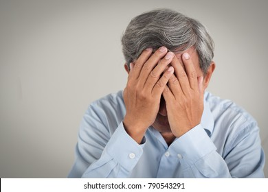 sick stressed failed old senior man doing facepalm gesture; failed depressed face palm senior old man suffering from failure or depression; pathetic poor old man; old senior man model with gray hair
