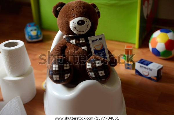 Sick teddy bear on the potty having digestive problems and taking smecta medicine