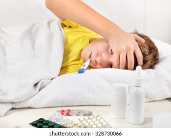 Sick Teenager with Thermometer in the Bed