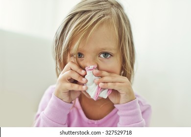 sick toddler girl with handkerchief at the home