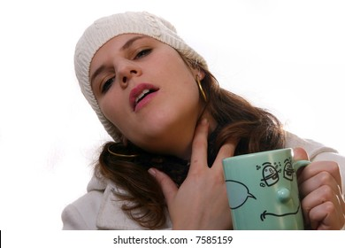 Sick In Winter A young woman is holding a cup of tea. She is sick and in pain with winter gear on. Isolated over white with space for text.