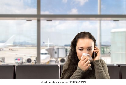 sick woman calling doctor urgently at the airport