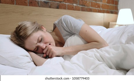 Sick Woman Coughing Lying in Bed On Side, Cough