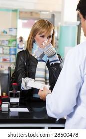 sick woman giving prescription to pharmacist
