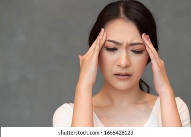 sick woman having fever due to virus outbreak; concept of biohazard, biological hazard, preventive health care, disease quarantine, coronavirus outbreak, sickness containment, COVID-19 coronavirus