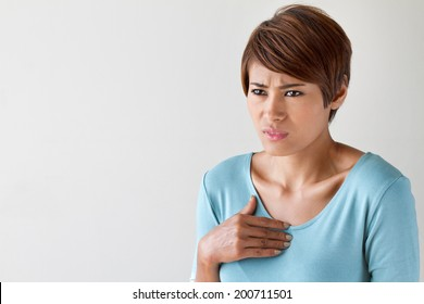 sick woman with heart attack, chest pain, health problem with blank area for text or copy space
