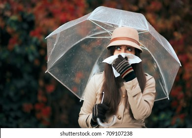 Sick Woman Holding  Umbrella in Autumn Rain Blowing Her Nose - Allergic girl with runny nose feeling under the weather