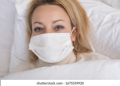 Sick woman lying in bed with high fever. Virus infection.