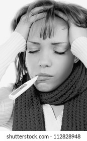 sick woman with warm clothes and thermometer. toned picture