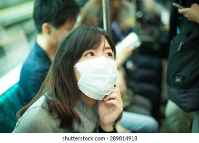 Sick woman wearing mask on her face.Travel on the train.