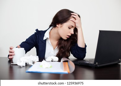 Sick woman at work with headache