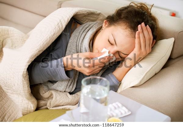 Sick Woman.Flu.Woman Caught Cold. Sneezing into Tissue. Headache. Virus .Medicines