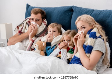 sick young family lying in bed