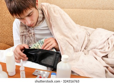 Sick Young Man check the Wallet with the Money on the Sofa at the Home