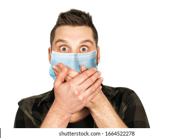 Sick young man with a surprised look in a medical mask. Virus protection during an influenza epidemic. corona virus disease 2019