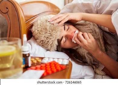 Sick young woman on the bed in the room