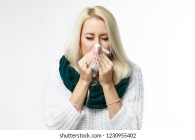 Sickness woman  blow up nose in paper tissue. Isolated portrait on white.