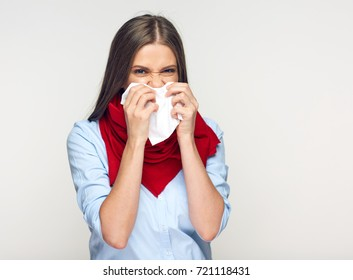 Sickness woman blowing his nose in paper tissue. Isolated on white background illness girl.