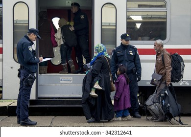 SID, SERBIA - NOVEMBER 14, 2015: Refugees boarding a train to the refugee camp of Slavonski Brod, in Croatia.