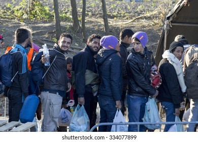 SID, SERBIA - OCTOBER 31, 2015: Refugees waiting to cross the Serbo-Croatian border between the cities of Sid (Serbia) and Bapska (Croatia).