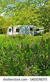 Sidbury, Devon  / England - 5/11/2019:A view of modern caravans on site at Putts Corner, a rural campsite run by the Caravan & Motorhome Club, near Honiton, Devon. Quiet woodland location.