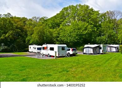 Sidbury, Devon  / England - 5/8/2019: A view of modern caravans on site at Putts Corner, a rural campsite run by the Caravan & Motorhome Club, near Honiton, Devon. Quiet woodland location.
