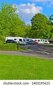 Sidbury, Devon  / England - 5/9/2019:A view of modern caravans on site at Putts Corner, a rural campsite run by the Caravan & Motorhome Club, near Honiton, Devon. Quiet woodland location.